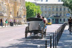 Tourist carriage with people on the streets in historical city c Royalty Free Stock Photos