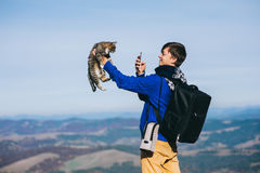 Tourist and cat mountain autumn Royalty Free Stock Photo
