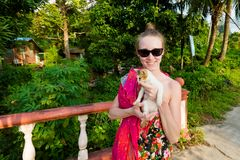 Tourist with cat Tioman island. Girl tourist with cat on tropical Tioman island in Malaysia. Travelling in south east asia Stock Photos