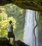 Tourist In Cave At Misol Ha Waterfall Royalty Free Stock Photography