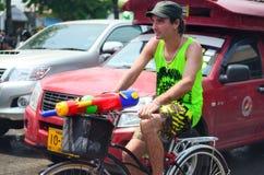 Tourist celebrating Songkran with bike Royalty Free Stock Photography