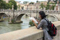 Tourist in the center of Rome. Woman looks into the map in the center of Rome Royalty Free Stock Image