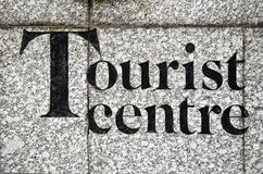 Tourist centre. Tourist center inscribed on a stone wall Royalty Free Stock Images