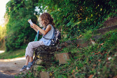 Tourist child girl with map traveling on summer vacations in Piran Royalty Free Stock Photography