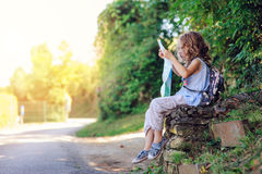 Tourist child girl with map traveling on summer vacations in Piran Stock Photo
