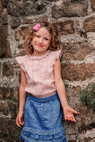 Tourist child girl at stone wall on the walk in Piran, Slovenia Stock Image