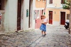 Tourist child girl on the walk on streets in Piran, Slovenia Stock Photo