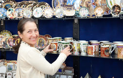 Tourist  chooses souvenir cup in egyptian shop Stock Photos