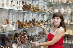 Tourist  chooses souvenir  in egyptian shop Stock Image