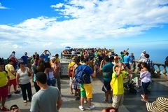 Tourist at the Christ Redeemer Corcovado mountain. RIO DE JANEIRO, JUNE 12: Tourists on the Corcovado Hill visiting the Christ Redeemer with their national team Stock Photos