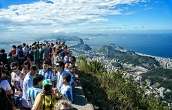 Tourist at the Christ Redeemer Corcovado mountain. RIO DE JANEIRO, JUNE 12: Tourists on the Corcovado Hill visiting the Christ Redeemer with their national team Royalty Free Stock Image
