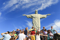 Tourist with Christ the Redeemer on top of Corcovado, Brazil Stock Images