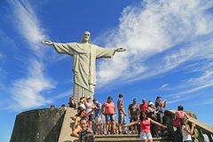Tourist with Christ the Redeemer on top of Corcovado, Brazil Stock Photos