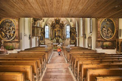 Tourist in a church. View into the centre aisle of a Bavarian church Stock Photos