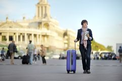 Tourist in the city. (middle age woman with luggage Stock Image