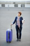 Tourist in the city. (middle age woman with paper cup and luggage Royalty Free Stock Photo