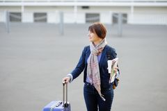 Tourist in the city. (middle age woman with paper cup and luggage Stock Photography