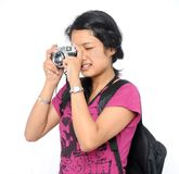A tourist clicking a photo with her camera. Royalty Free Stock Photo