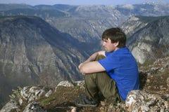 Tourist on a cliff Stock Photos
