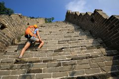 Tourist climbing to the top of greatwall enjoy the view. Woman tourist climbing to the top of greatwall enjoy the view Stock Photography