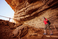 Tourist is climbing on the way from the grot. Woman tourist is climbing on the way from the grot Stock Image