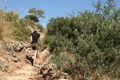 Tourist climbing in Zingaro nature reserve Sicily Italy Stock Images