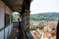 Tourist in The Clock Tower in Sighisoara, Romania Royalty Free Stock Photography