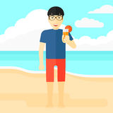 Tourist with cocktail on the beach. Royalty Free Stock Images