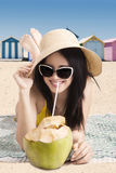 Tourist with coconut fruit at shore Stock Photo