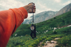Tourist with compass in mountains Stock Photo