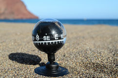 Tourist Compass in the Sand Royalty Free Stock Photo