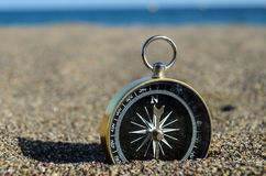 Tourist Compass in the Sand Stock Image