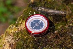 Tourist compass on a wooden texture in the open air.  stock images