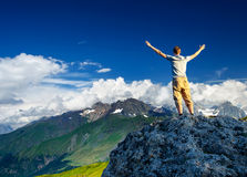 Tourist concept. Tourist on high peak. Sport and active life concept Royalty Free Stock Image