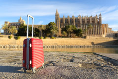 Tourist concept with a suit case in a touristic place Royalty Free Stock Photo