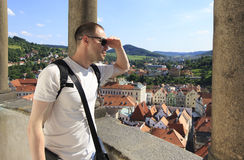 Tourist considers the historical city center from the tower. Royalty Free Stock Image