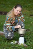 Tourist cooking tea  on gasoline stove Royalty Free Stock Photos