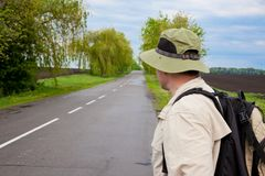 Tourist on a country road Royalty Free Stock Photography