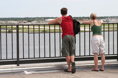 Tourist Couple. A young couple enjoying a scenic view Stock Photo