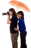 Tourist couple. And umbrella white isolate Stock Image