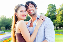 Tourist couple in city park hugging in love Stock Image
