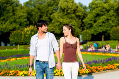 Tourist couple in city park walking Stock Photography