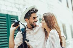 Couple enjoying sightseeing and exploring city. Tourist couple enjoying sightseeing and exploring city Stock Photos