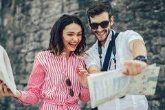 Tourist couple enjoying sightseeing, exploring city. Tourist couple enjoying sightseeing and exploring city Stock Image