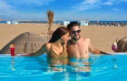 Tourist couple having bath in infinity pool Royalty Free Stock Photos