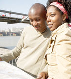 Tourist couple in London with map. Stock Photography
