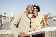 Tourist couple in London with map. Stock Photo