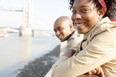 Tourist couple in London with map. Royalty Free Stock Images