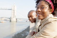 Tourist couple in London with map. Royalty Free Stock Photos