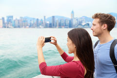 Tourist couple looking Victoria harbour Hong Kong Royalty Free Stock Photo